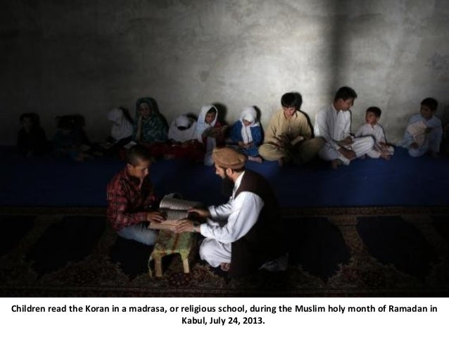 Children read the Koran in a madrasa, or religious school, during the Muslim holy month of Ramadan in Kabul, July 24, 2013.