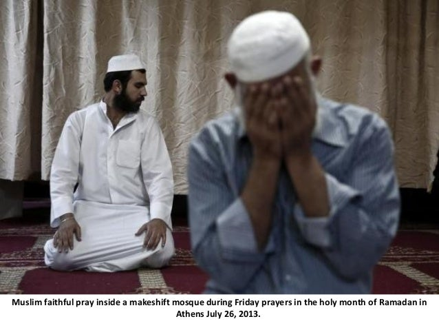 Muslim faithful pray inside a makeshift mosque during Friday prayers in the holy month of Ramadan in Athens July 26, 2013.
