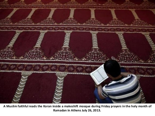 A Muslim faithful reads the Koran inside a makeshift mosque during Friday prayers in the holy month of Ramadan in Athens J...