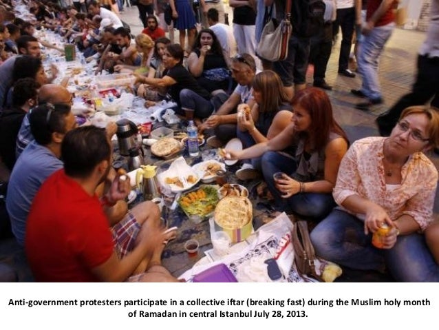 Anti-government protesters participate in a collective iftar (breaking fast) during the Muslim holy month of Ramadan in ce...