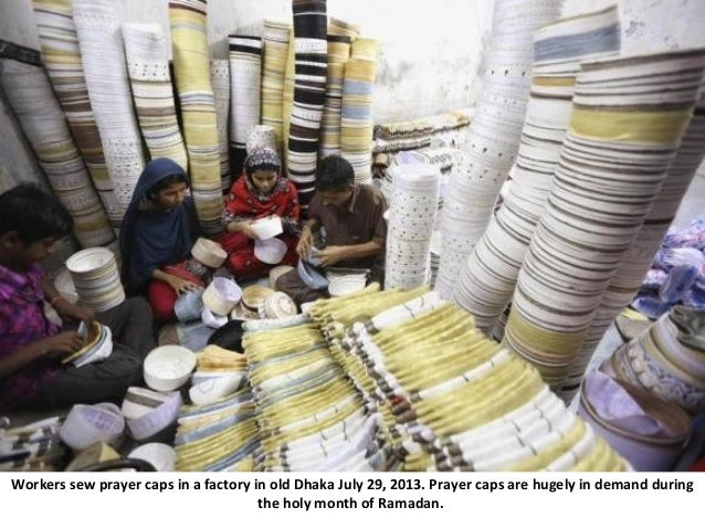 Workers sew prayer caps in a factory in old Dhaka July 29, 2013. Prayer caps are hugely in demand during the holy month of...