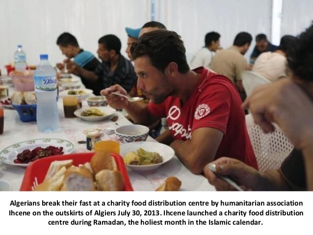 Algerians break their fast at a charity food distribution centre by humanitarian association Ihcene on the outskirts of Al...