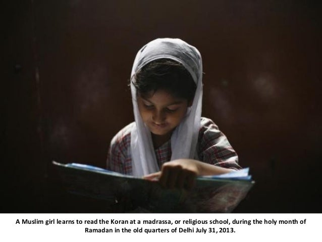 A Muslim girl learns to read the Koran at a madrassa, or religious school, during the holy month of Ramadan in the old qua...
