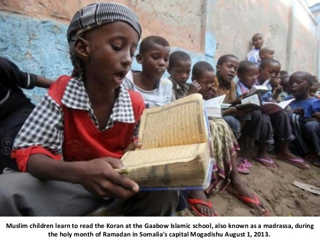 Muslim children learn to read the Koran at the Gaabow Islamic school, also known as a madrassa, during the holy month of R...