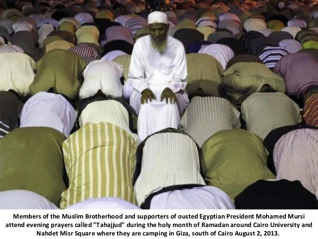 Members of the Muslim Brotherhood and supporters of ousted Egyptian President Mohamed Mursi attend evening prayers called ...