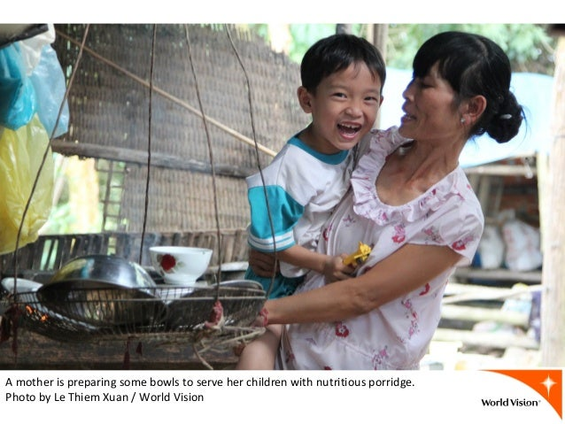 A mother is preparing some bowls to serve her children with nutritious porridge. Photo by Le Thiem Xuan / World Vision