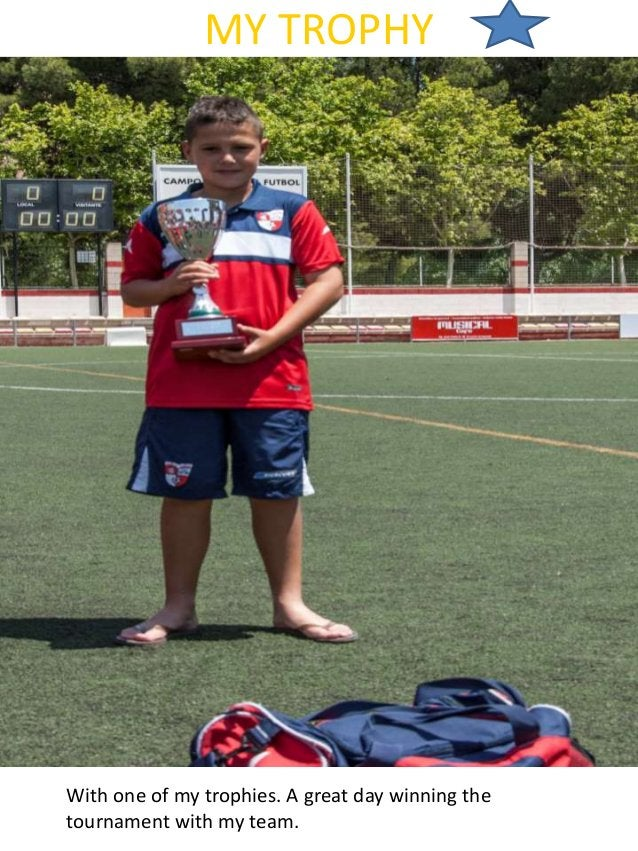MY TROPHY With one of my trophies. A great day winning the tournament with my team.