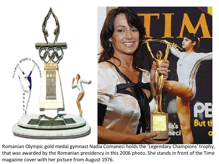 Romanian Olympic gold medal gymnast Nadia Comaneci holds the 'Legendary Champions' trophy, that was awarded by the Romania...