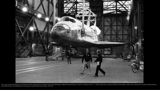 The crew of Space Shuttle 51-L walks out from their quarters en route to the Space Shuttle orbiter Challenger early Tuesda...