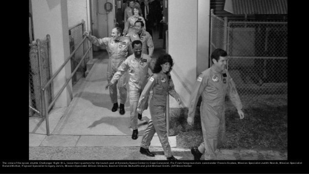 Classmates of the son of Christa McAuliffe, America's first schoolteacher to become an astronaut, cheer as the space shutt...