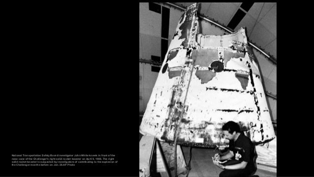 The remains of the shuttle Challenger's seven crew members are transferred from seven hearses to a MAC C-141 transport pla...