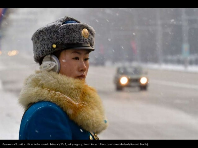 Female traffic police officer in the snow in February 2013, in Pyongyang, North Korea. (Photo by Andrew Macleod/Barcroft M...