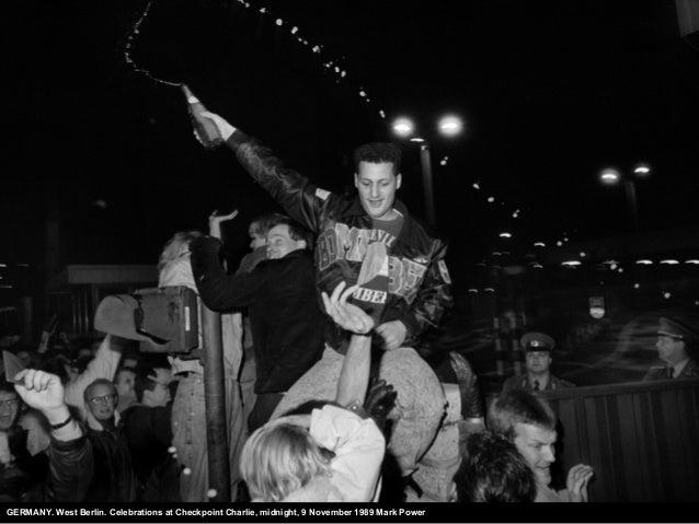 GERMANY. West Berlin. Celebrations at Checkpoint Charlie, midnight, 9 November 1989 Mark Power