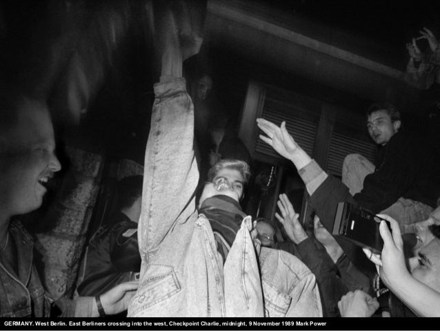 GERMANY. West Berlin. East Berliners crossing into the west, Checkpoint Charlie, midnight, 9 November 1989 Mark Power