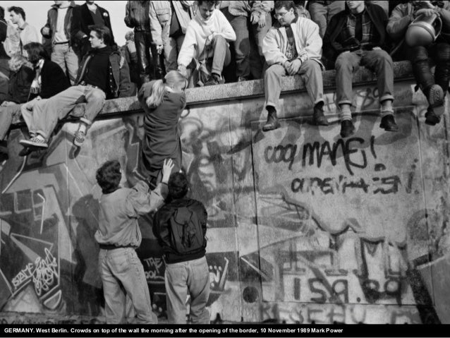 GERMANY. West Berlin. Crowds on top of the wall the morning after the opening of the border, 10 November 1989 Mark Power