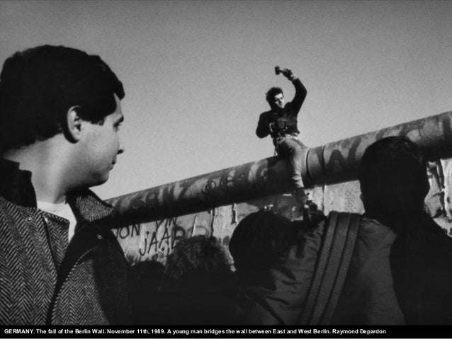 GERMANY. The fall of the Berlin Wall. November 11th, 1989. A young man bridges the wall between East and West Berlin. Raym...