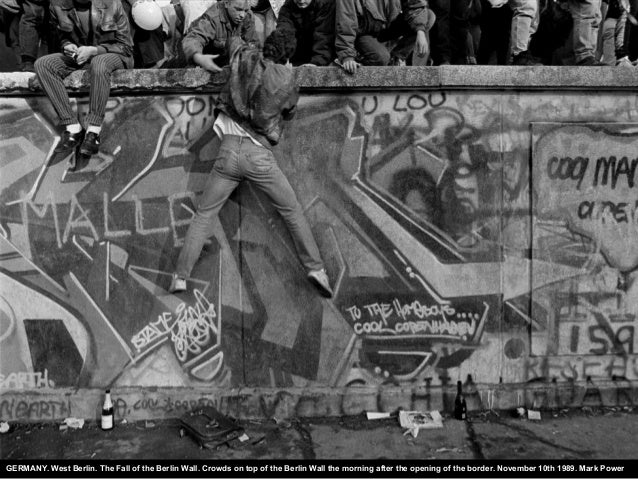GERMANY. West Berlin. The Fall of the Berlin Wall. Crowds on top of the Berlin Wall the morning after the opening of the b...