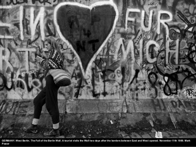 GERMANY. West Berlin. The Fall of the Berlin Wall. A tourist visits the Wall two days after the borders between East and W...