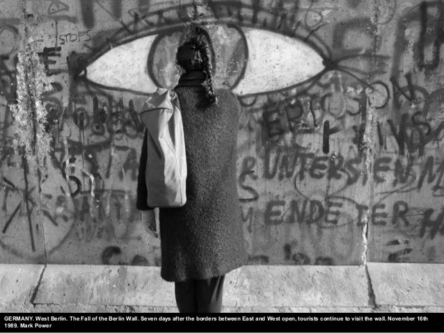 GERMANY. West Berlin. The Fall of the Berlin Wall. Seven days after the borders between East and West open, tourists conti...