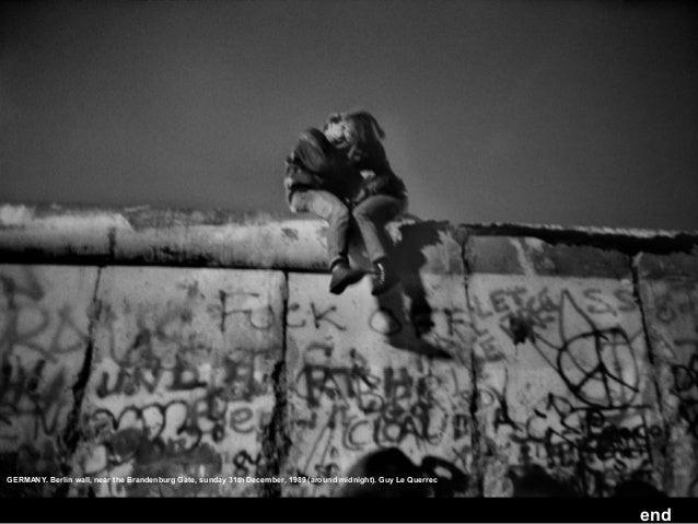 GERMANY. Berlin wall, near the Brandenburg Gate, sunday 31th December, 1989 (around midnight). Guy Le Querrec  end