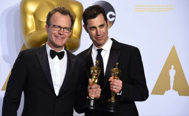 """Tom McCarthy and Josh Singer pose with the award for best original screenplay for """"Spotlight Photograph: Jordan Strauss/In..."""