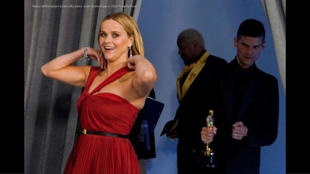Reese Witherspoon enters the press room at the Oscars. Chris Pizzello/Pool