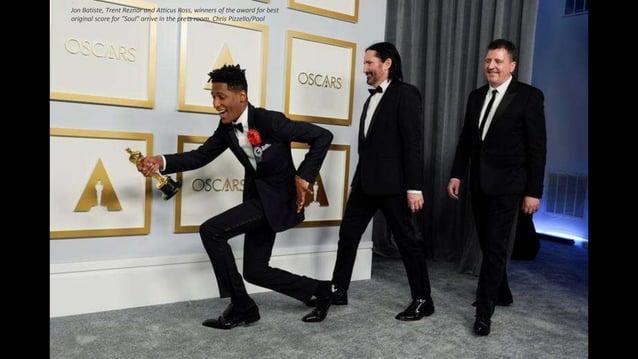 "Jon Batiste, Trent Reznor and Atticus Ross, winners of the award for best original score for ""Soul"" arrive in the press ro..."
