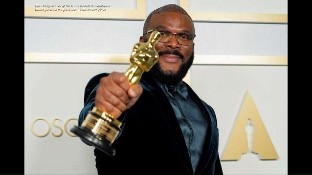 Tyler Perry, winner of the Jean Hersholt Humanitarian Award, poses in the press room. Chris Pizzello/Pool