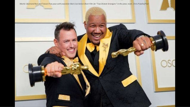 """Martin Desmond Roe and Travon Free pose with award for Best Live Action Short Film for """"Two Distant Strangers"""" in the pres..."""