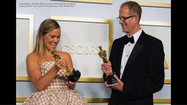 """Dana Murray, and Pete Docter, winners of the award for animated feature film for """"Soul"""", pose in the press room. Chris Piz..."""