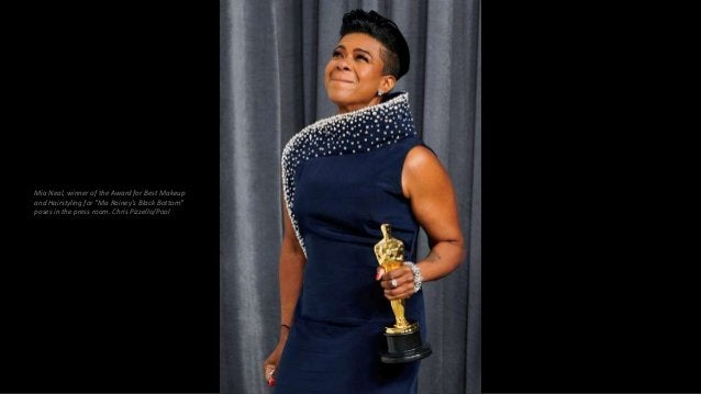 """Mia Neal, winner of the Award for Best Makeup and Hairstyling for """"Ma Rainey's Black Bottom"""" poses in the press room. Chri..."""