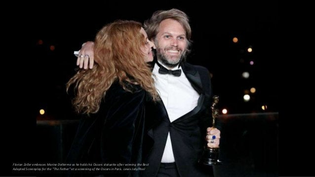 Florian Zeller embraces Marine Delterme as he holds his Oscars statuette after winning the Best Adapted Screenplay for the...