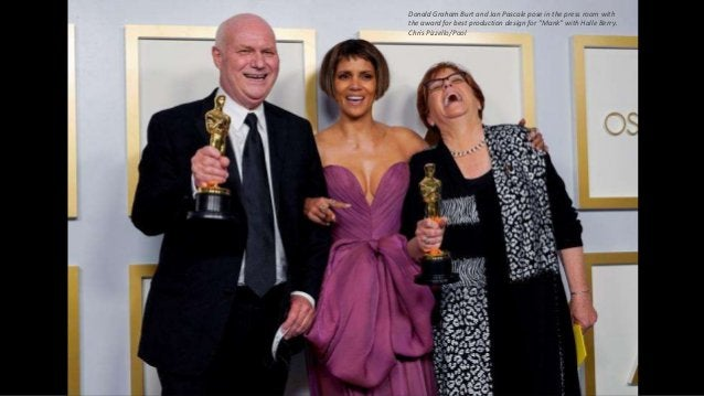 """Donald Graham Burt and Jan Pascale pose in the press room with the award for best production design for """"Mank"""" with Halle ..."""