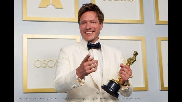 """Thomas Vinterberg from Denmark poses with the award for best international feature film for """"Another Round"""" in the press r..."""
