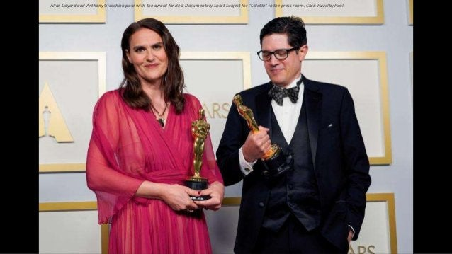 """Alice Doyard and Anthony Giacchino pose with the award for Best Documentary Short Subject for """"Colette"""" in the press room...."""