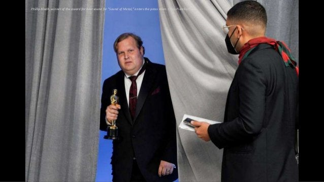 """Phillip Bladh, winner of the award for best sound for """"Sound of Metal,"""" enters the press room. Chris Pizzello/Pool"""