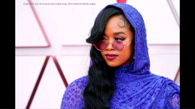 Singer H.E.R. won the Oscar for best original song. Chris Pizzelo/Pool/Getty Images