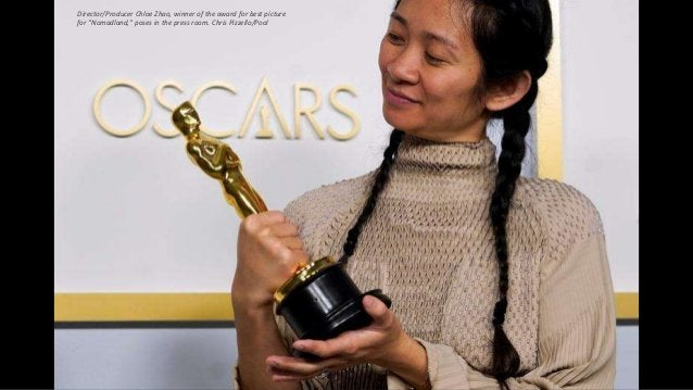 """Director/Producer Chloe Zhao, winner of the award for best picture for """"Nomadland,"""" poses in the press room. Chris Pizzell..."""