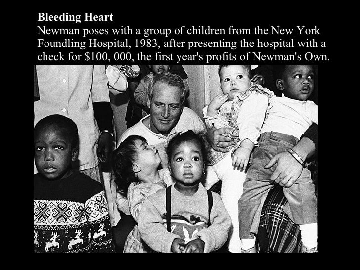 Bleeding Heart Newman poses with a group of children from the New York Foundling Hospital, 1983, after presenting the hosp...