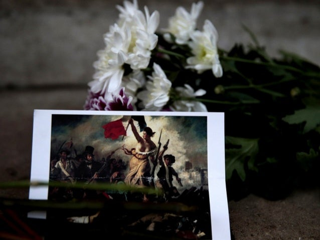 A postcard and flowers are left in tribute to victims of Paris attacks outside the French Embassy in London, Britain Novem...