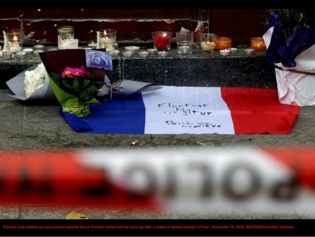 Flowers are seen placed on the doorstep of the Le Carillon restaurant the morning after a series of deadly attacks in Pari...
