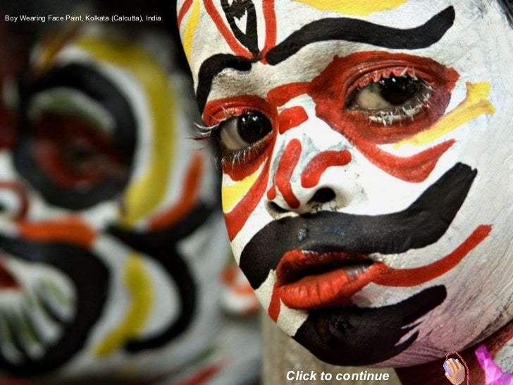 Boy Wearing Face Paint, Kolkata (Calcutta), India Click to continue