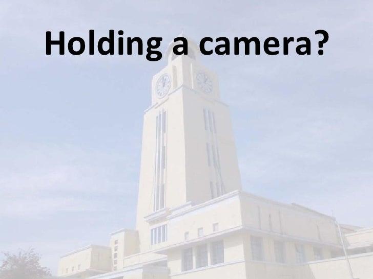 Holding a camera?