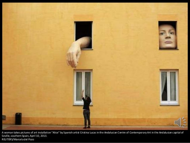 """A woman takes pictures of art installation """"Alice"""" by Spanish artist Cristina Lucas in the Andalusian Centre of Contempora..."""
