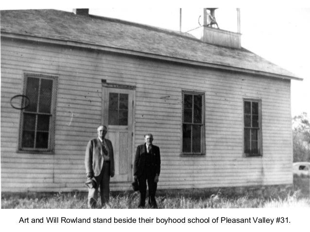 Art and Will Rowland stand beside their boyhood school of Pleasant Valley #31.