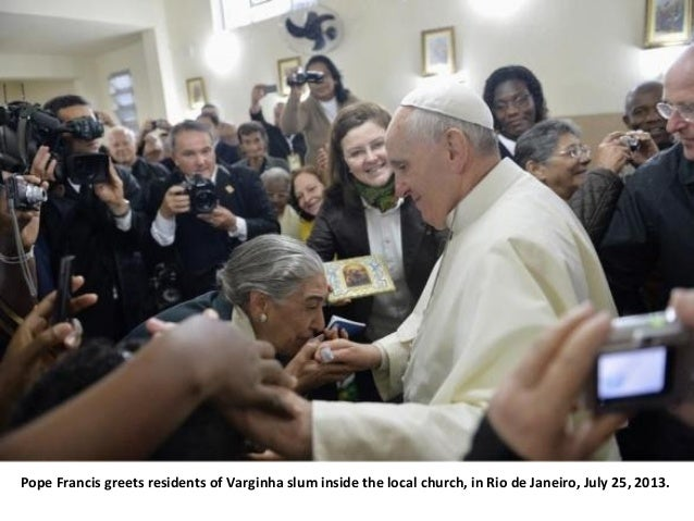 Pope Francis greets residents of Varginha slum inside the local church, in Rio de Janeiro, July 25, 2013.