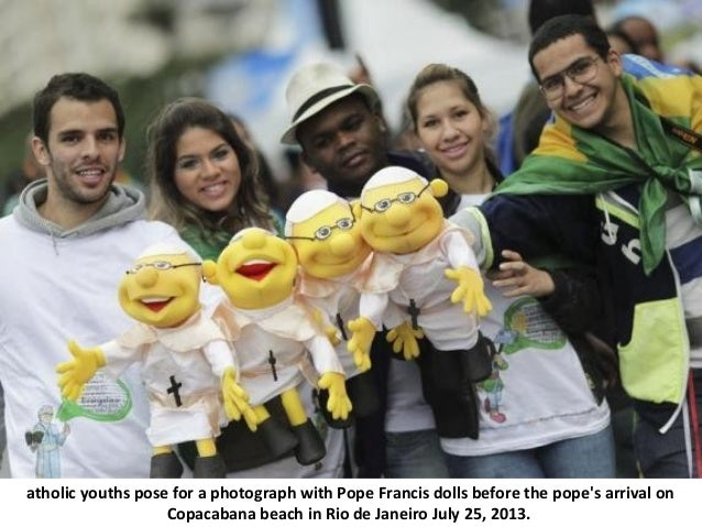 atholic youths pose for a photograph with Pope Francis dolls before the pope's arrival on Copacabana beach in Rio de Janei...
