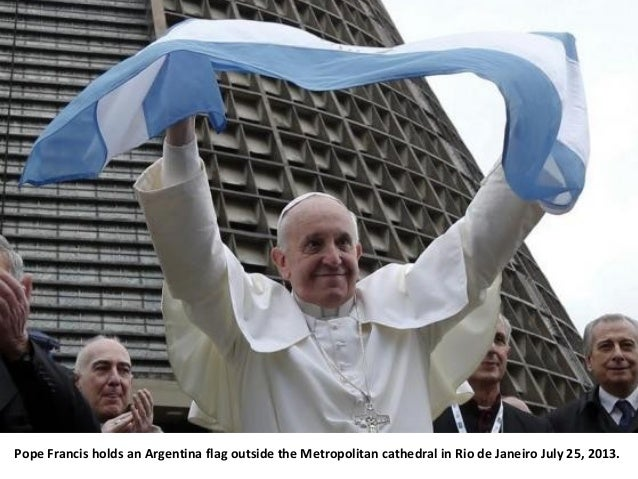 Pope Francis holds an Argentina flag outside the Metropolitan cathedral in Rio de Janeiro July 25, 2013.