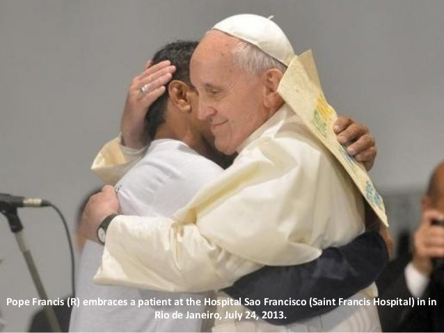 Pope Francis (R) embraces a patient at the Hospital Sao Francisco (Saint Francis Hospital) in in Rio de Janeiro, July 24, ...