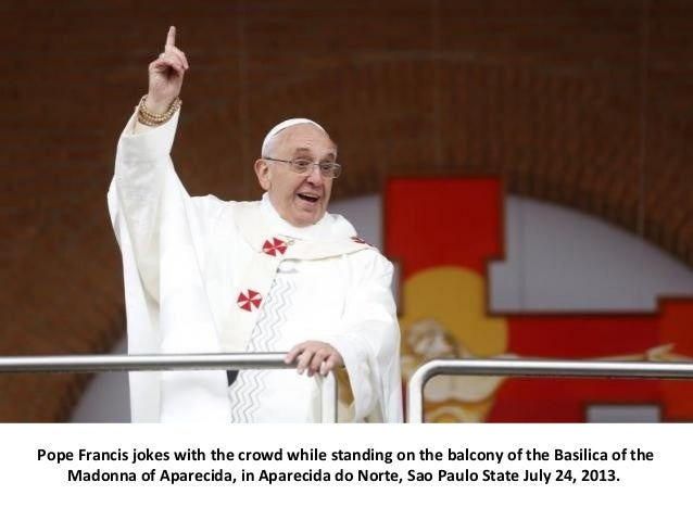 Pope Francis jokes with the crowd while standing on the balcony of the Basilica of the Madonna of Aparecida, in Aparecida ...